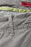 Casual cotton men's trousers. Detail of gray casual cotton men's trousers Royalty Free Stock Photo