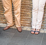 Casual Couple Against a Brick Wall Royalty Free Stock Photography