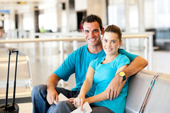 Casual couple at airport. Casual young couple waiting for flight at airport Royalty Free Stock Image