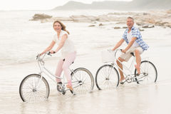 Casual couple on a bike ride Royalty Free Stock Image