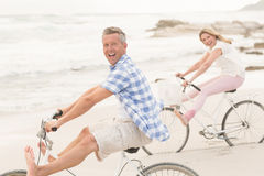 Casual couple on a bike ride Stock Photo