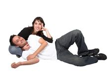 Casual couple on the floor Royalty Free Stock Photography