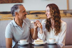 Casual couple having coffee and cake together Royalty Free Stock Photo