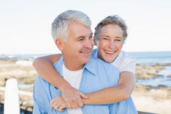 Casual couple having fun by the sea Royalty Free Stock Photography