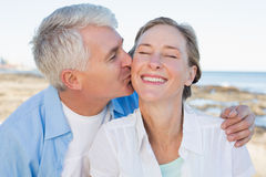 Casual couple having fun by the sea Royalty Free Stock Photo