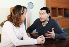 Casual couple having serious talking Royalty Free Stock Images