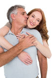 Casual couple hugging and smiling Stock Photo