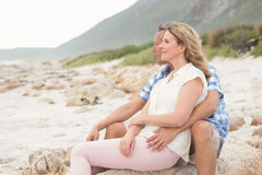 Casual couple looking to sea Royalty Free Stock Image