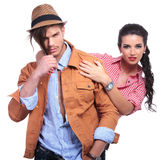 Casual couple looking at you, woman behind man Royalty Free Stock Images