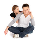 Casual Couple in Love Sitting Royalty Free Stock Photography