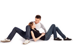 Casual Couple Lying Down on White Royalty Free Stock Photography