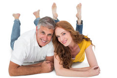 Casual couple lying on floor Royalty Free Stock Photography