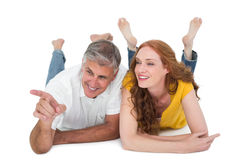Casual couple lying on floor Royalty Free Stock Image