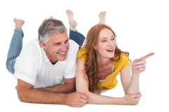 Casual couple lying on floor Royalty Free Stock Images