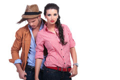 Casual couple with man behind, looking down Royalty Free Stock Image