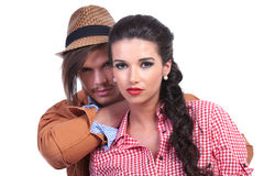 Casual couple with man holding hand on her shoulder Royalty Free Stock Images