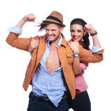 Casual couple with man showing his biceps Stock Images