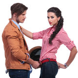 Casual couple with man taking her belt off Stock Photo