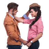 Casual couple with man taking woman's hat off Stock Images