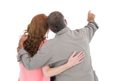 Casual couple pointing and looking Stock Image