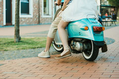 Casual couple riding on scooter outdoors Royalty Free Stock Photography