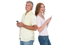 Casual couple sending text messages Stock Image