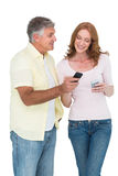 Casual couple sending text messages Royalty Free Stock Photo