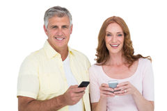 Casual couple sending text messages Royalty Free Stock Image