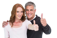 Casual couple showing thumbs up Stock Images