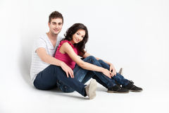 Casual couple sitting down Stock Images