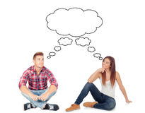 Casual couple sitting on the floor isolated Royalty Free Stock Images