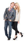 Casual Couple Smiling. Casual guy and beautiful girl isolated on white background. Full length portrait of a friendly couple being happy together Royalty Free Stock Photography