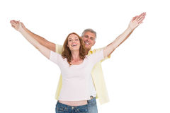 Casual couple smiling with arms raised Stock Photos