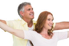 Casual couple smiling with arms raised Royalty Free Stock Photo
