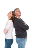 Casual couple smiling and looking up Stock Photo