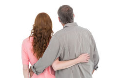 Casual couple standing arm around Royalty Free Stock Images