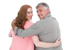 Casual couple standing arms around Royalty Free Stock Photography
