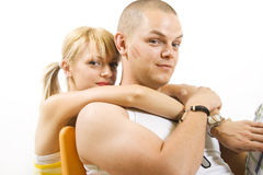 Casual couple together on sofa Stock Image