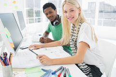 Casual couple using computer in office Stock Image