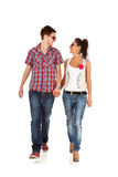 Casual couple is walking. Towards the camera  on White, looking at each other Royalty Free Stock Image