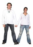 Casual couple in white holding hands Royalty Free Stock Image