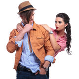 Casual couple with woman looking at man Royalty Free Stock Photography