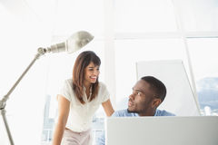 Casual coworkers smiling at each other Royalty Free Stock Image