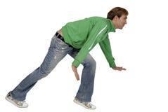 casual crouching man young Στοκ εικόνα με δικαίωμα ελεύθερης χρήσης