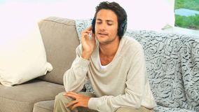 Casual darkhaired man with headphones Stock Photo