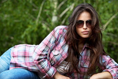 Casual day style. Beautiful young woman in casual clothes with sunglasses, outdoor portrait Stock Photos