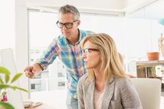 Casual designer briefing his colleague Stock Photography