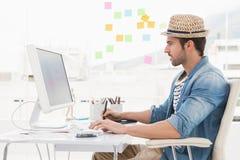 Casual designer using computer and digitizer Stock Photos