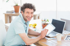 Casual designer using graphics tablet and laptop Stock Images