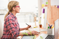 Casual designer working with computer Royalty Free Stock Photos